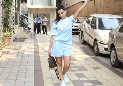 Nora Fatehi in Karl Kani's varsity mesh tee and shorts showed a cool girl's favourite OOTD; Yay or Nay?